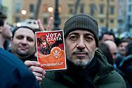 Roma, 11 Gennaio 2013.In fila per depositare i simboli dei partiti al ministero dell'Interno  in vista del voto..Una delle persone in fila mostra un volantino con scritto: Vota pirata..