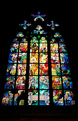 Prague, Czech Republic:  The famed Mucha Stained Glass Window brings thousands of art lovers to the interior, St. Vitus Cathedral (Katedrala Sv. Vita) within the Castle Square complex.  Considered a prime example of Art Nouveau, it was created in 1931 by Czech artist Alfons Mucha on a nationalistic theme.