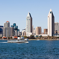 High resolution photo of San Diego skyline and whale watching tour boat in San Diego Bay in Southern California.