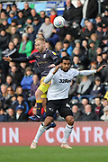 Sheffield Wednesday midfielder Barry Bannan and Derby County midfielder Tom Huddlestone challenge for the ball in the airduring the EFL Sky Bet Championship match between Derby County and Sheffield Wednesday at the Pride Park, Derby, England on 9 March 2019.