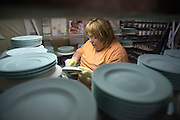 Renee Fettinger of Antioch finishes an individual soup tureen liner in Antioch Thursday morning. Pickard China recently made a full set of china for the White House which was used during the recent state dinner with Japanese leaders. The 320 person set included 12 total pieces each. The cost was $362,000.<br />