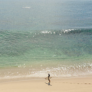 Surfer at Playa Palmilla getting ready. San Jose del Cabo