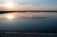 Il complesso produttivo delle saline è situato nel comune italiano di Margherita di Savoia (nome dato dagli abitanti in onore alla regina d'Italia che molto si adoperò nei confronti dei salinieri) nella provincia di Barletta-Andria-Trani in Puglia. Sono le più grandi d'Europa e le seconde nel mondo, in grado di produrre circa la metà del sale marino nazionale (500.000 di tonnellate annue).All'interno dei suoi bacini si sono insediate popolazioni di uccelli migratori e non, divenuti stanziali quali il fenicottero rosa, airone cenerino, garzetta, avocetta, cavaliere d'Italia, chiurlo, chiurlotello, fischione, volpoca..Il tramonto sulle acque di un bacino per la produzione del sale.