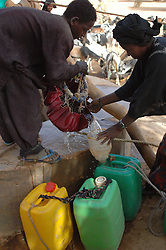 Niger, Agadez, Tidene, 2007. Containers of every sort are used to collect and transport water. Tuareg from twenty miles around must share this single well.