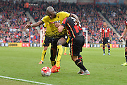 Watford FC defender Allan Nyom and AFC Bournemouth's midfielder Matt Ritchie grapple during the Barclays Premier League match between Bournemouth and Watford at the Goldsands Stadium, Bournemouth, England on 3 October 2015. Photo by Mark Davies.