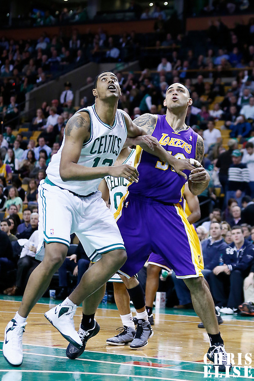 07 February 2013: Boston Celtics center Fab Melo (13) vies for the rebound with Los Angeles Lakers center Robert Sacre (50) during the Boston Celtics 116-95 victory over the Los Angeles Lakers at the TD Garden, Boston, Massachusetts, USA.