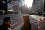 people waiting at pedestrian street crossing Tokyo Japan