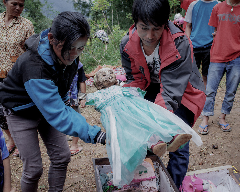 Ditha's parents, Ruslin and Adi, return her body back into the coffin after putting on a new dress for their daughter.  Ditha suddenly passed away from an illness four years ago when she was just 1yr old.<br />