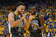 April 30, 2019; Oakland, CA, USA; Golden State Warriors guard Stephen Curry (30) and forward Kevin Durant (35) react against the Houston Rockets during the second quarter in game two of the second round of the 2019 NBA Playoffs at Oracle Arena.