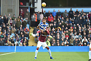 QPR defender Darnell Furlong (2) heads the ball under pressure from Aston Villa striker Jonathan Kodjia (26) during the EFL Sky Bet Championship match between Aston Villa and Queens Park Rangers at Villa Park, Birmingham, England on 1 January 2019.