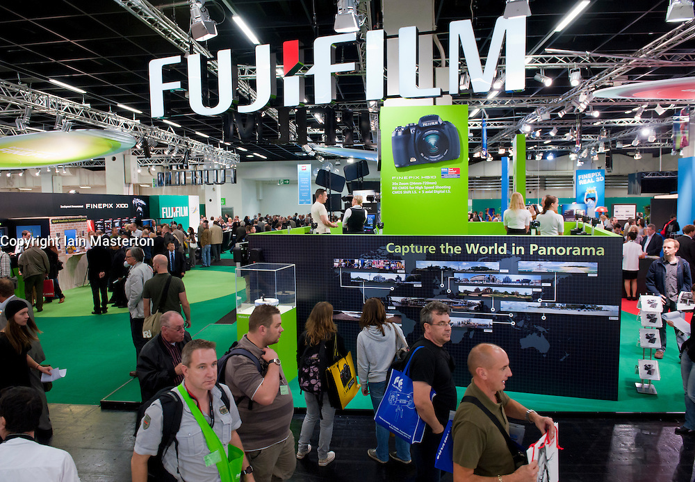 Crowds passing Fujifilm stand at Photokina digital imaging trade show in Cologne Germany