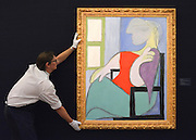 "© Licensed to London News Pictures. 31/01/2013. London, UK An employee holds Pablo Picasso's ""Femme assize press dune fenetre"" 1932 which is estimated to raise 25-35million GBP. Preview of highlights from Sotheby's forthcoming February sales of Impressionist & Modern Art and Contemporary Art in London, including works by Picasso, Bacon, Monet, Richter and Miró. Photo credit : Stephen Simpson/LNP"