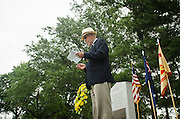 Robert Cutler, executive director of the Bakers Creek Memorial Association's U.S. branch, speaks during a ceremony marking 71th anniversary of a crash that killed 40 Army Air Corps members at Bakers Creek, Australia at Joint Base Myer-Henderson Hall in Arlington, Va. on June 13, 2014. Photo by Kris Connor