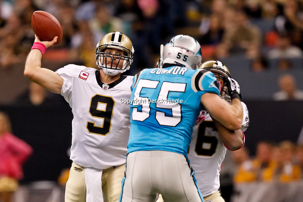 October 3, 2010; New Orleans, LA, USA; New Orleans Saints quarterback Drew Brees (9) throws a pass against the Carolina Panthers during the first quarter at the Louisiana Superdome. Mandatory Credit: Derick E. Hingle