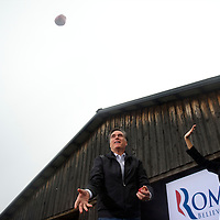 Republican Presidential candidate MITT ROMNEY throws apples into the crowd after arriving to  at a rally in the Harmon Tree Farm.  The South Carolina primary is on 21 January.