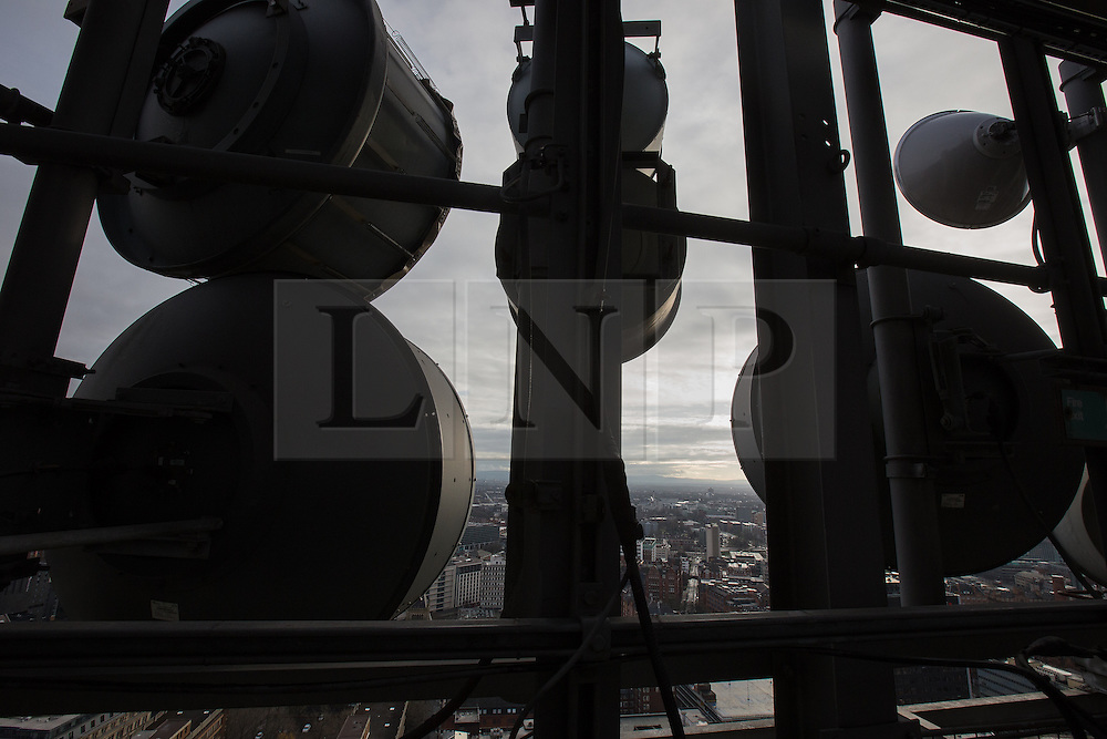 © Licensed to London News Pictures . 07/12/2013 . Microwave transmitter dishes . Transmitters on top of City Tower , from where several radio stations and numerous Internet services and communications infrastructure for the city are based . Cityscape view of Manchester . Photo credit : Joel Goodman/LNP