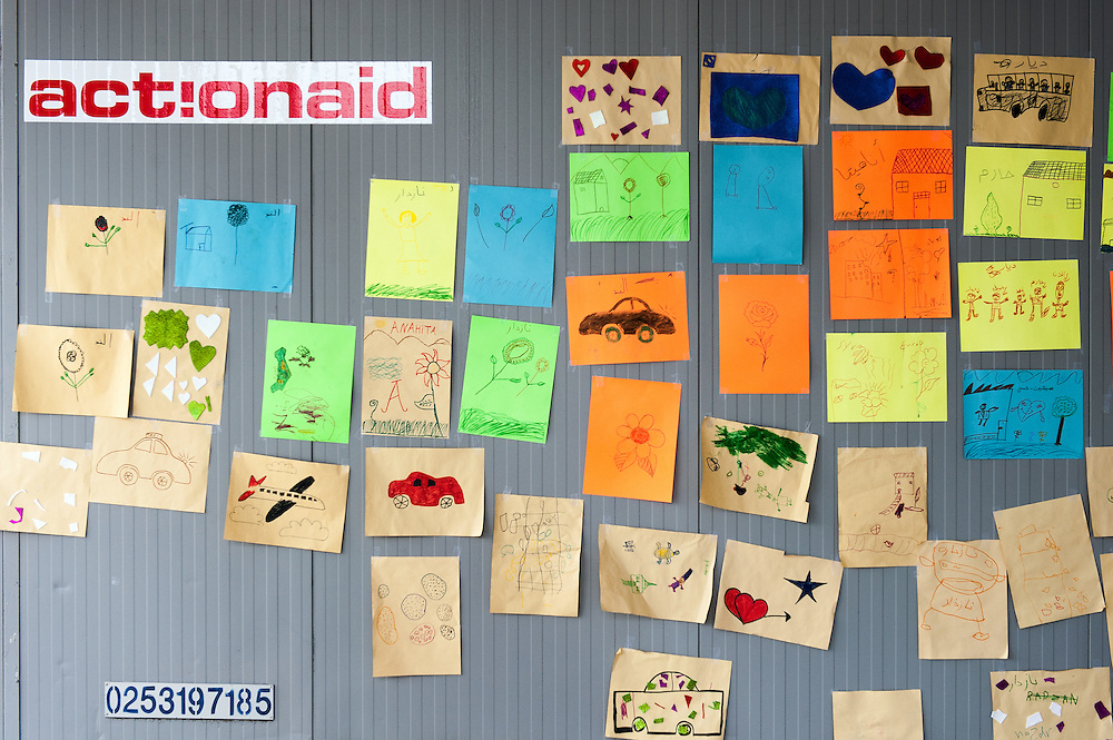 Children's drawings outside the ActionAid's office container in Kara Tepe camp, Lesvos, Greece