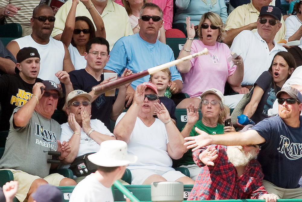 Tampa Bay Rays' Kelly Shoppach's bat sails into the stands as fans react during the Rays' spring training game against the Pirates Sunday, Feb. 27, 2011 in Bradenton.