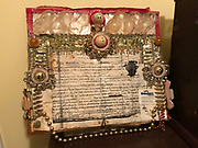 art work- certificate of ordination hung in grocery- made by preacher hair ties and smilie faces and beads***listed near bottom on  id sheet -maybe on list else where -only photo<br />
