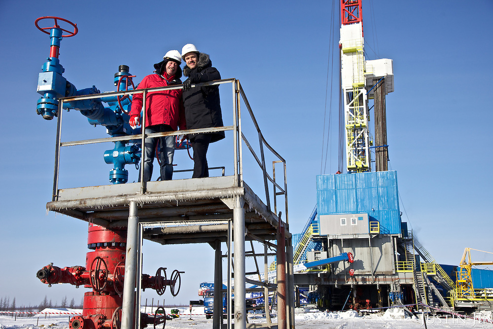 Achimgaz Director Sergei Vlasov (L) and deputy director Ingo Neubert pose on top of an Achimgaz oil well. In the back a drilling well is in operation in Novy Urengoi, Siberia, Russia.