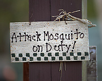 """Attack Mosquito on Duty"" sign at Clyde Butchers Swamp Cottage. Big Cypress Swamp in Florida. Image taken with a Nikon Df camera and 70-200 mm f/4 VR lens (ISO 800, 200 mm, f/4, 1/200 sec)."