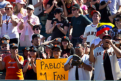 May 30, 2010; San Francisco, CA, USA;  San Francisco Giants fans cheers on San Francisco Giants third baseman Pablo Sandoval (not pictured) during the ninth inning against the Arizona Diamondbacks at AT&T Park.  San Francisco defeated Arizona 6-5 in 10 innings.