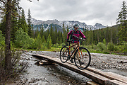 With 1km of rerouting discouraging our bikes on flooded Jacques Lake Trail on 01 July 2019, we instead hiked on foot for 6 miles to scenic Beaver Lake, then nearly to Summit Lake before turned back by rain, in Jasper National Park, Canadian Rockies, Alberta, Canada. Jasper is the largest national park in the Canadian Rocky Mountain Parks World Heritage Site, honored by UNESCO in 1984.