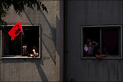 People watches the caravan pass by.<br /> After 36 years, Chile's most popular folk singer, Victor Jara was mourned and buried. About 10.000 people attended to his vigil and funeral. Victor Jara was assassinated on September 15 1973 by Pinochet`s military officials of at least 43 gunshots and massive beatings. His 1973 funeral had to be made in private because of military restrictions.