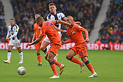 Millwall midfielder Jiri Skalak (26) and Millwall defender James Meredith (3) stop West Bromwich Albion midfielder Harvey Barnes (15), on loan from Leicester City attacking during the EFL Sky Bet Championship match between West Bromwich Albion and Millwall at The Hawthorns, West Bromwich, England on 22 September 2018.