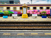 10 JULY 2018 - NAKHON PATHOM, THAILAND:  A freight train goes through the station in Nakhon Pathom. Nakhon Pathom is about 35 miles west of Bangkok. It is one of the oldest cities in Thailand, archeological evidence suggests there was a settlement on the site of present Nakhon Pathom in the 6th century CE, centuries before the Siamese empires existed. The city is widely considered the first Buddhist community in Thailand and the nearly 400 foot tall Phra Pathom Chedi is considered the first Buddhist temple in Thailand.    PHOTO BY JACK KURTZ