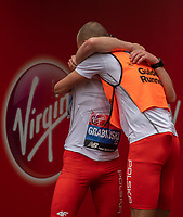 Marcin Grabinski POL is congratulated by his Guide Runner at the end of the World Para Athletics Marathon Championships T12 Men's Race. The Virgin Money London Marathon, 28 April 2019.<br /> <br /> Photo: Andrew Baker for Virgin Money London Marathon<br /> <br /> For further information: media@londonmarathonevents.co.uk