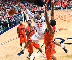 Virginia forward Mike Scott (32) grabs a rebound against VT.  The Virginia Cavaliers defeated the Virginia Tech Hokies 75-61 at the John Paul Jones Arena on the Grounds of the University of Virginia in Charlottesville, VA on February 18, 2009.