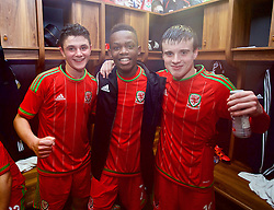 NEWPORT, WALES - Thursday, November 5, 2015: Wales' goal-scorers Steffan Buckeley, Rabbi Matonda and Sion Spence celebrate in the dressing room after retaining the Victory Shield with a 3-1 win over Northern Ireland during the Under-16's Victory Shield International match at Dragon Park. (Pic by David Rawcliffe/Propaganda)