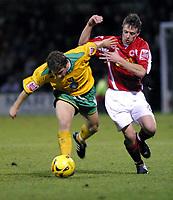 Photo: Dave Linney.<br />Crewe Alexandra v Norwich City. Coca Cola Championship.<br />10/12/2005.Jim Brennan(Norwich) battles past  Gary Roberts(Crewe)