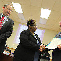 Sharon D. Gladney is congratulated by superintendent Jeff Clay and school board president Jim Edwards as part of Administrative Assistants and Board Clerks Appreciation Week.