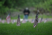 Day before Memorial Day, Willamette National Cemetery, man in background observing gravesite