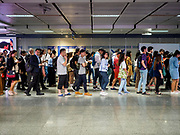 26 OCTOBER 2018 - BANGKOK, THAILAND:  Commuters wait to board subway trains (called the MRT in Bangkok) in the Sukhumvit MRT station.     PHOTO BY JACK KURTZ