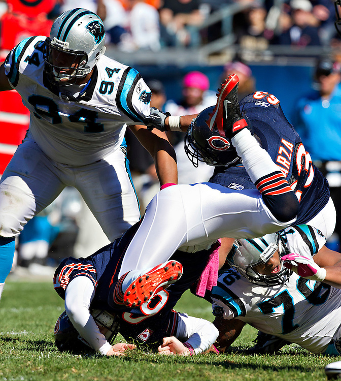 CHICAGO, IL - OCTOBER 2:  Jay Cutler #6 of the Chicago Bears gets thrown upside down by Greg Hardy #76 of the Carolina Panthers at Soldier Field on October 2, 2011 in Chicago, Illinois.  The Bears beat the Panthers 34 to 29.  (Photo by Wesley Hitt/Getty Images) *** Local Caption *** Jay Cutler; Greg Hardy