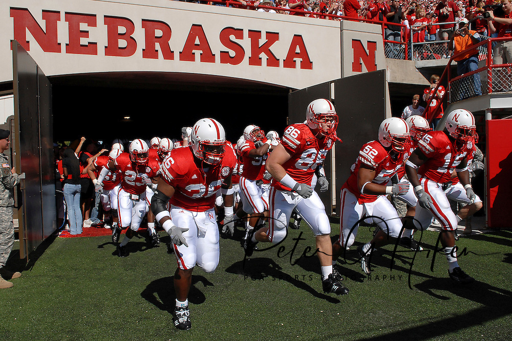 September 22, 2007 - Lincoln, NE..The Nebraska Cornhuskers run out onto the field before their game with the Ball State Cardinals, during a NCAA football game at Memorial Stadium in Lincoln, Nebraska on September 22, 2007...FBC:  The Huskers defeated the Cardinals 41-40.  .Photo by Peter G. Aiken/Cal Sport Media
