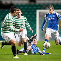 Celtic v St Johnstone...30.10.12      Scottish Communities Cup<br /> Kevin Moon and Murray Davidson tackle Kris Commons<br /> Picture by Graeme Hart.<br /> Copyright Perthshire Picture Agency<br /> Tel: 01738 623350  Mobile: 07990 594431