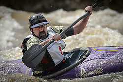 Kevin Olsen of Affton, Mo. races on the slalom course of the 45th Annual Missouri Whitewater Championships. Olsen placed second in the C1 Men's Plastic class, sixth in the K1 Men's Expert class, and third in the K1 Men's long plastic (30 and up) classes. The Missouri Whitewater Championships, held on the St. Francis River at the Millstream Gardens Conservation Area, is the oldest regional whitewater slalom race in the United States. Heavy rain in the days prior to the competition sent water levels on the St. Francis River to some of the highest heights that the race has ever been run. Only expert classes were run on the flood level race course.