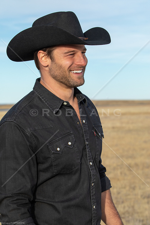 hot All American cowboy smiling outdoors