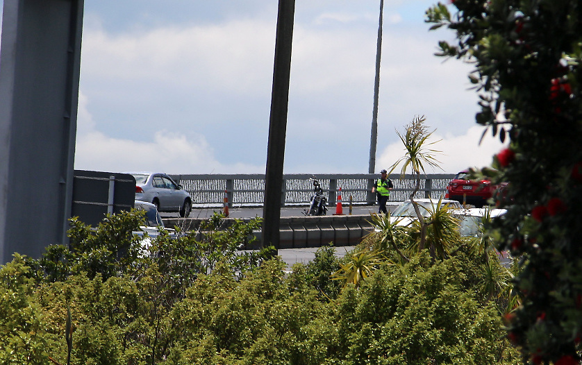 A middle aged motorcyclist was injured in an accident on the north bound lane of the Harbour Bridge causing traffic hold ups, Auckland, New Zealand, Saturday, December 06, 2014. Credit:SNPA / Daniel Hines  **VIDEO GRAB**