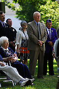 Sgt. David Hack, (tan suit) is joined by Hudson City Council President, David Basil (L) and Military Order of the Purple Heart Chaplain Richard Betts, of Warren (R) and police and community members as he awaits the presentation of a Purple Heart.