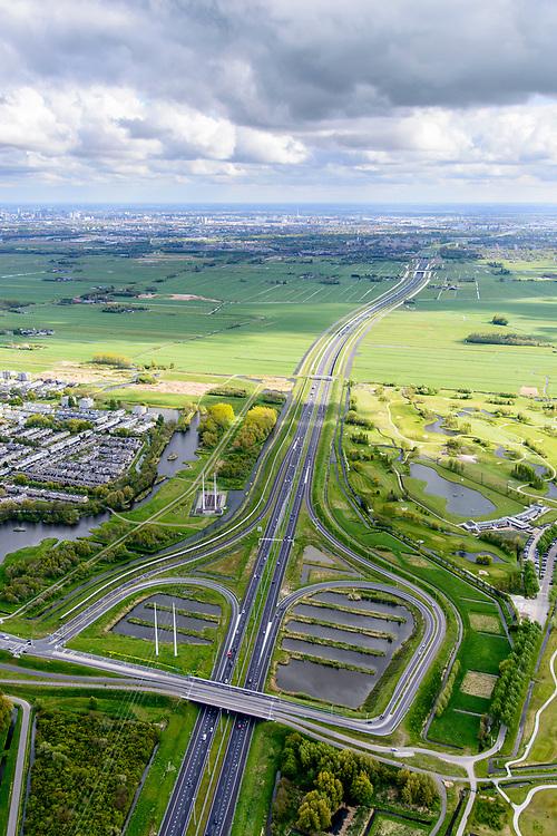 Nederland, Zuid-Holland, Gemeente Delft, 28-04-2017; Rijksweg A4 Midden-Delfland gezien vanaf knooppunt Delft naar Schiedam met ingang van de Ketheltunnel. De weg is (deels) verdiept aanglegd om  geluidsoverlast te verminderen en om beter in het omliggende landschap te passen.<br /> New road between Delft and Rotterdam, crossing rural area.<br /> <br /> luchtfoto (toeslag op standard tarieven);<br /> aerial photo (additional fee required);<br /> copyright foto/photo Siebe Swart