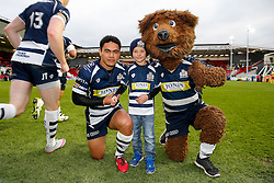 Bristol Rugby Winger David Lemi (capt) poses with the match mascot Joseph Tucker and Brizzly Bear as teh players run out onto the pitch - Mandatory byline: Rogan Thomson/JMP - 22/11/2015 - RUGBY UNION - Ashton Gate Stadium - Bristol, England - Bristol Rugby v Scarlets Premiership Select - B&I Cup.