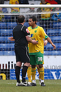 Oldham - Saturday February 26th, 2010 :  Korey Smith of Norwich argues with the ref during the Coca Cola League One match at Boundary Park, Oldham. (Pic by Paul Chesterton/Focus Images)..