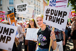 © Licensed to London News Pictures. 13/07/2018. London, UK. Tens of thousands of demonstrators march through central London to protest against the President of the United States, Donald Trump, and his ongoing four-day visit to the UK. The demonstration began at Portland Place and ended with a rally at Trafalgar Sqaure. Photo credit : Tom Nicholson/LNP