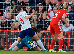 SOUTHAMPTON, ENGLAND - Friday, April 6, 2018: Wales' goalkeeper Laura O'Sullivan and England's Abbie McManus during the FIFA Women's World Cup 2019 Qualifying Round Group 1 match between England and Wales at St. Mary's Stadium. (Pic by David Rawcliffe/Propaganda)