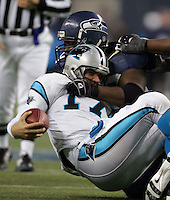 Seattle's Rocky Bernard tackles Carolinas QB Jake Delhomme (bottom) during the Carolina Panthers at Seattle Seahawks NFC Championship game at Qwest Field in Seattle. Washington on January 22, 2006.